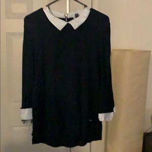 Sweater over woven shirt